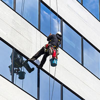 alpinist climber clean the windows
